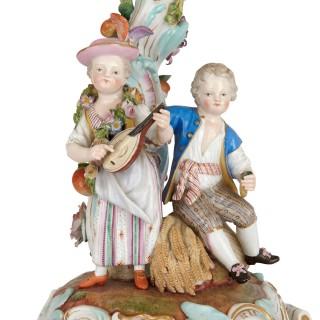 German Rococo style three piece porcelain clock set by Meissen
