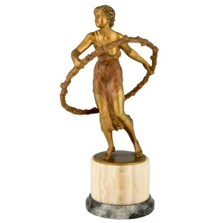 Art Deco bronze sculpture of a girl with hoop.
