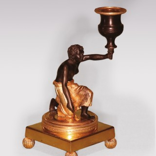 Early 19th Century bronze and ormolu Candlestick in the form of Nubian