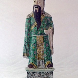 Kangxi Famille verte Biscuit Porcelain of a Standing Immortal