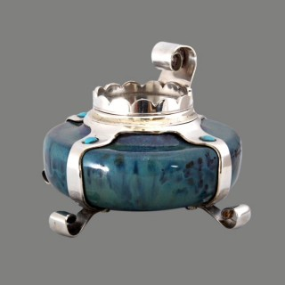 A Cymric silver inkwell with Ruskin pottery, for Liberty & Co
