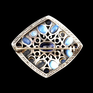 A Sibyl Dunlop signed moonstone and natural Ceylon sapphire brooch