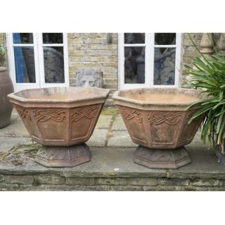 A pair of Liberty terracotta 'Seigfried' garden planters after designs by Archibald Knox