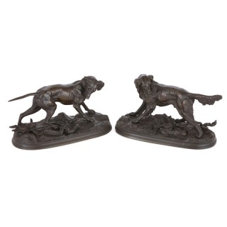 Pair of antique French bronze sculptures of dogs