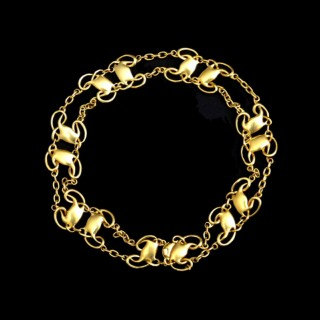 A rare Archibald Knox gold bracelet for Liberty
