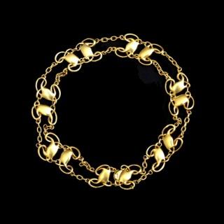 A rare Archibald Knox gold bracelet for Liberty