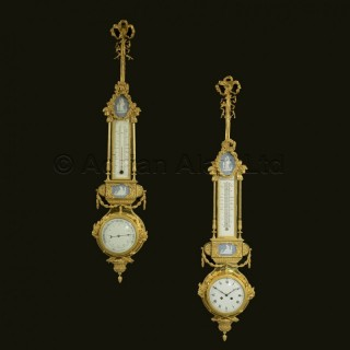 A Neoclassical Style Gilt-Bronze Hanging Clock and Barometer