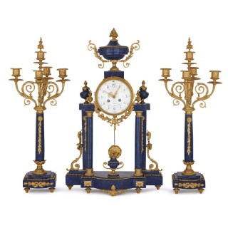 Antique Neoclassical style lapis lazuli and gilt bronze clock set