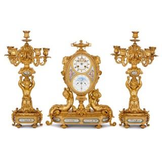 Antique French gilt bronze and Sevres style porcelain clock set