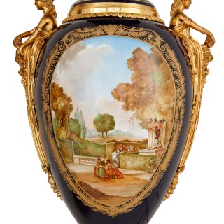 Colossal pair of French gilt bronze and blue Sevres style porcelain vases