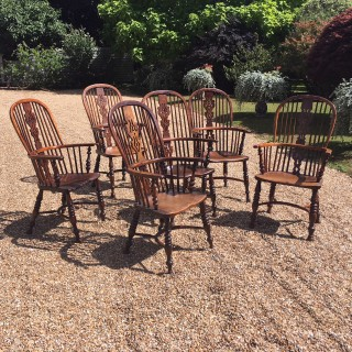 A rare set of English yew wood Windsor chairs