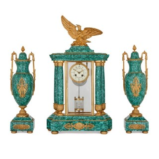 Gilt bronze mounted malachite three piece clock garniture
