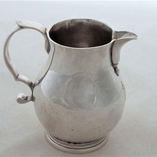 Quality crested George I silver sparrow beak jug London 1725 William Paradise