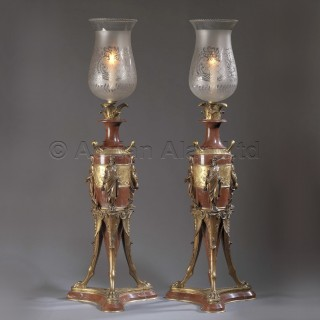 A Pair of Parcel Rouge Marble Candelabra