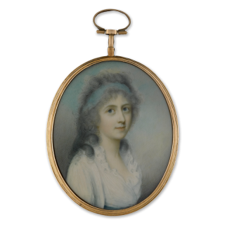 A portrait miniature of a young Lady, wearing white dress with frilled collar and a blue bandeau in her powdered hair, circa 1790
