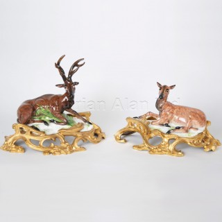 A Pair of Porcelain Figures of a Stag and Doe