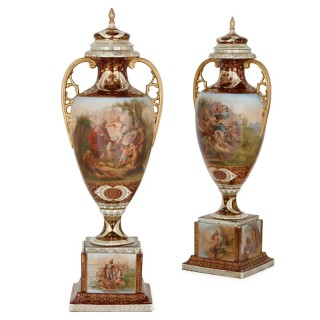 Pair of parcel-gilt Royal Vienna style maroon porcelain vases