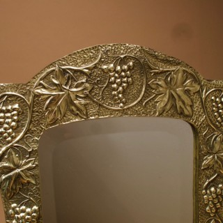 A Decorative and Stylish Art Nouveau Embossed brass Mirror.