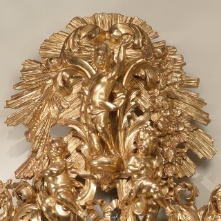 An Italian Gilt Wood Mirror Carved With Allegorical Figures