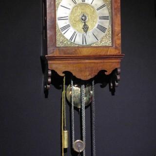 A very rare original Amsterdam walnut hood clock, circa: 1725,
