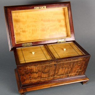 AN EARLY VICTORIAN WALNUT TEA CADDY
