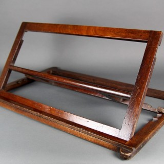 AN EARLY 19TH CENTURY MAHOGANY BOOK STAND