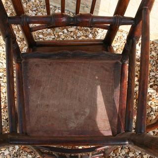 A SET OF FOUR ASH SPINDLE BACK CHAIRS