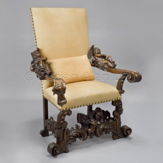 A Finely Carved Venetian Baroque Style Figural Walnut Throne Chair