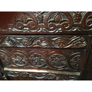 A mid 17th century carved Oak Court Cupboard