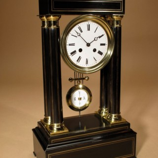 Ebony and Ebonised with Brass Inlaid Portico Clock.