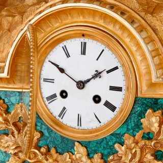 19th Century French gilt bronze and malachite mantel clock