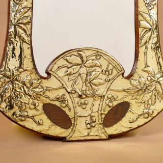 A French Very Decorative and Elegant  Art Nouveau Embossed Brass and Walnut Mirror. circa :1900