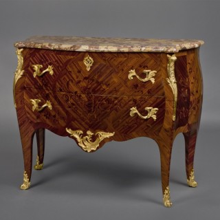 A Louis XV Style Marquetry Inlaid Commode With a Marble Top