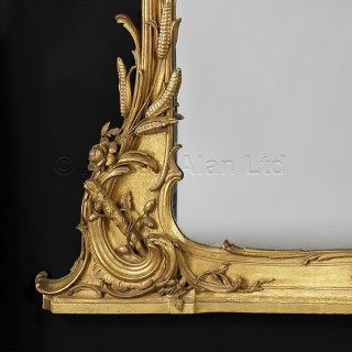 A Very Fine Carved Giltwood Mirror