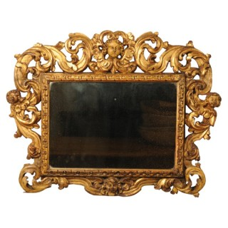 Carved giltwood Sansovino frame, with mercury mirror plate