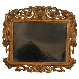 Carved giltwood Sansovino frame, with mercury plate