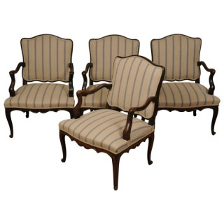 A suite of four Louis XV walnut fauteuils, French, mid 18th century