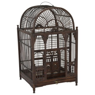 A wooden birdcage of architectural form