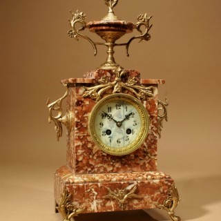 An Unusual Very Decorative French Marble and Gilded Brass Mantel Clock.