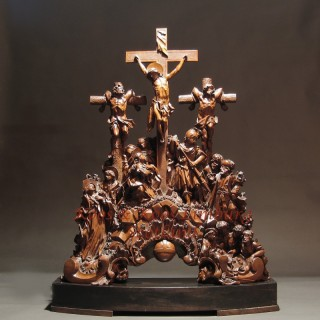 A magnificent carved pear wood group of the Crucifixion. Signed: Witz