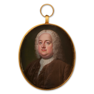 Portrait miniature of A Gentleman, previously identified as Robert Walpole, 1st Earl of Orford (1676-1745), wearing a brown velvet coat and waistcoat, frilled cravat and powdered wig, c.1730