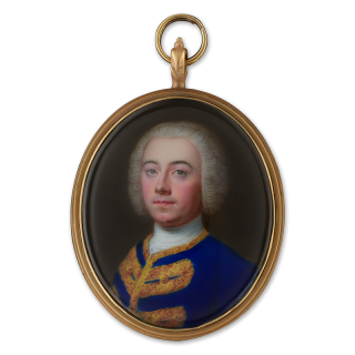 A Portrait enamel of a Nobleman, wearing bright blue collarless jacket with gold braid and white stock, powdered wig worn en queue, c. 1750
