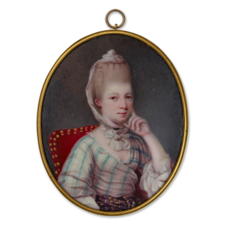 A portrait enamel of a young Lady, wearing white dress with green stripes, striped waist sash and white lace cap over her powdered hair, c.1775