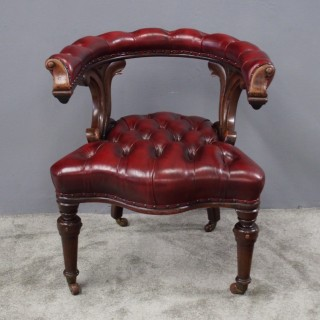 Oak and Burgundy Leather Horseshoe Captains Chair