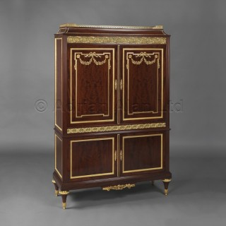 A Louis XVI Style Gilt Bronze Mounted Mahogany Cabinet