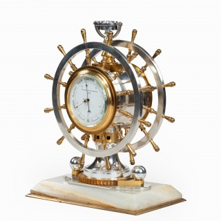 An unusual Victorian double steering-wheel desk clock and barometer