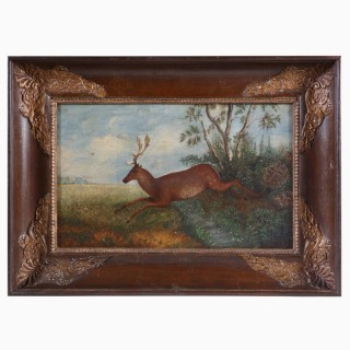 A CHARLES X PRIMITIVE OIL ON CANVAS PAINTING OF A DEER LEAPING