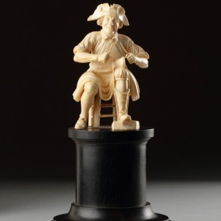German Carved Ivory Figure of a Shoemaker
