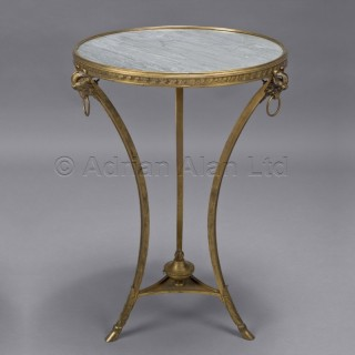 A Transitional Style Gilt-Bronze Gueridon with a Grey Marble Top