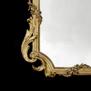 A Fine Louis XV Style Carved Giltwood Mirror